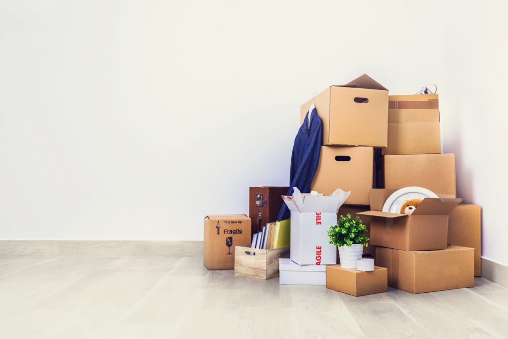 Packed cardboard boxes and stuff during moving into new home